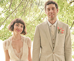 Gianna & JeremyGianna's and Jeremy's wedding rings were passed fastened to a handmade pocket-sized rice-filled pillow. The design was composed of a patchwork of wood-block printed handkerchiefs made from natural dyes that Gianna carried back from one of her trips to India.    At that time, she didn't imagine those handkerchiefs would become a ritual object in her own wedding ceremony!  But she knew this:  her family still believed in actually carrying a handkerchief. They unapologetically wipe their tears at happy occasions with the handkerchiefs they rescue from their purses and pockets.     The pillow reminds us to always be gentle with those we love and take the time to express ourselves just as Gianna took the time to craft this pillow, while the novelty of carrying a handkerchief for happy occasions is something we might wish to borrow from the Cosentino family.  Gianna especially likes the idea of re-inventing this old-school tradition. And now, let's all indulge in the Cosentino tradition of happy tears as we bless the wedding rings.